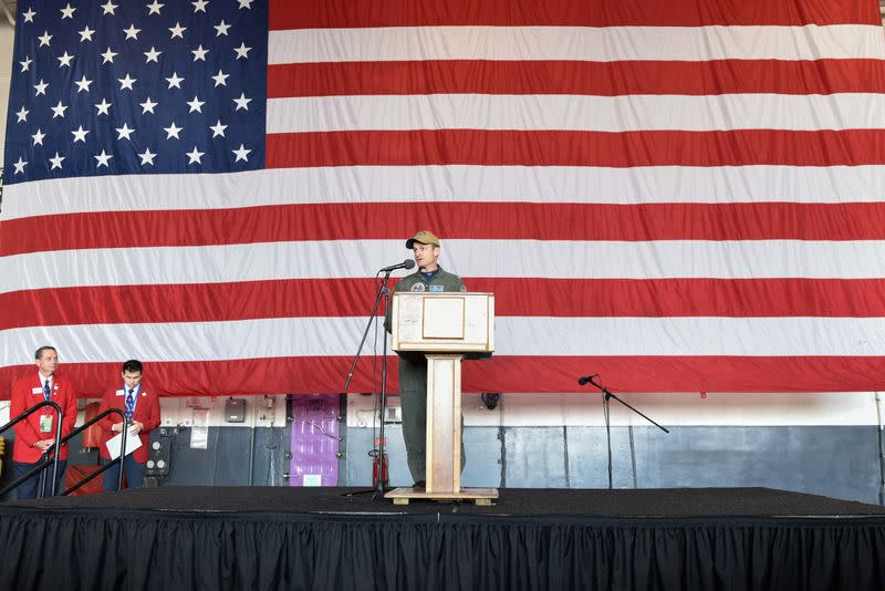 Captain Brett Crozier, commanding officer of the U.S. Navy aircraft carrier USS Theodore Roosevelt, speaks in San Diego