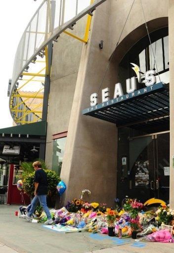 A memorial for NFL Legend Junior Seau builds as fans show their respect to the recently deceased football star at the entrance of Seau's Restaurant in Mission Valley, on May 3, in San Diego, California
