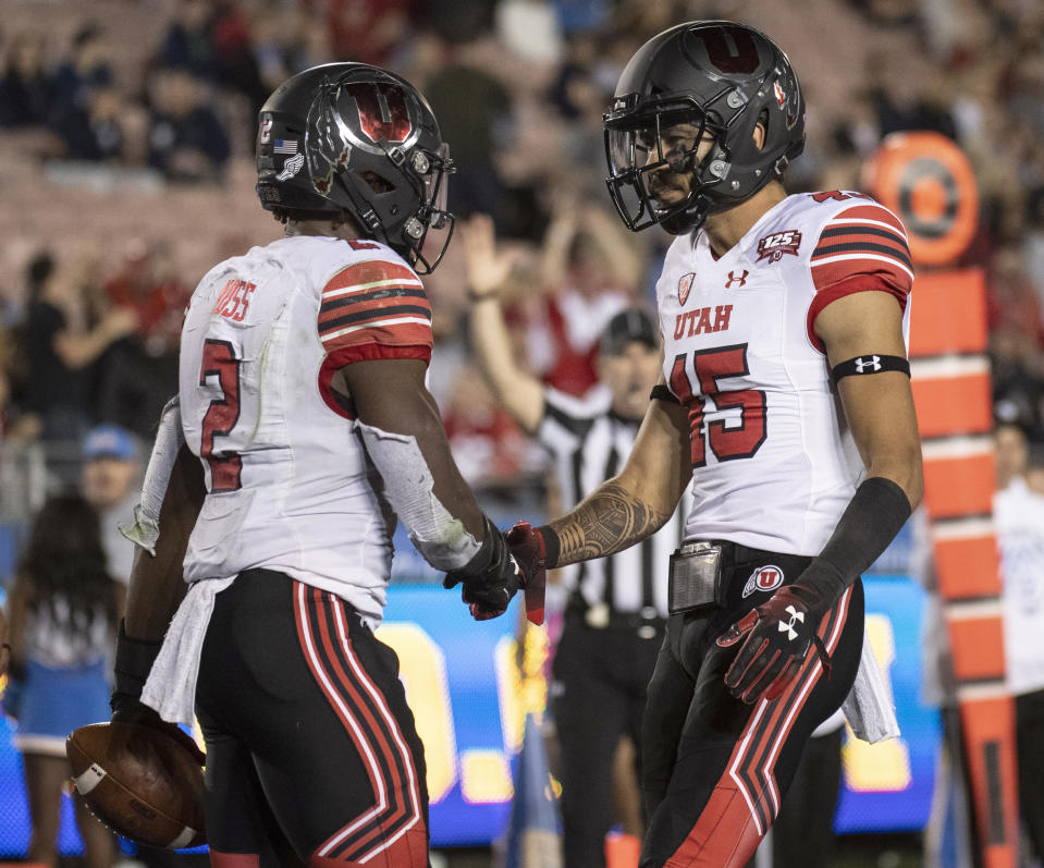 Utah running back Zack Moss (L) is coming back in 2019. (AP Photo/Kyusung Gong)
