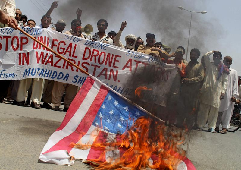 Pakistani protesters burn a representation of a U.S. flag to condemn a drone attack in the Pakistani tribal area of Waziristan which killed Taliban leader Waliur Rehman, Thursday, May 30, 2013 in Multan, Pakistan. The Pakistani Taliban's deputy leader was buried hours after he was killed in a U.S. drone strike, Pakistani intelligence officials and militants said Thursday. (AP Photo/M. Abbass)