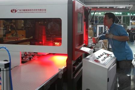 Employee works at the factory of Guangdong LiShun Yuan Intelligent Automation Co, a paper box packaging machinery in Dongguan