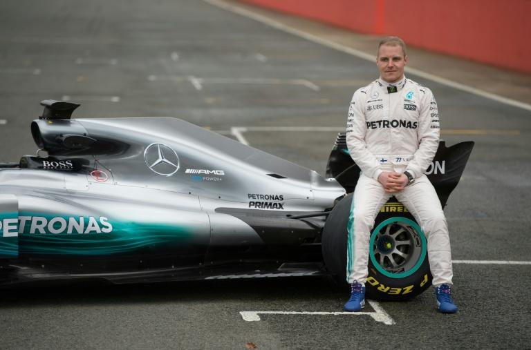 Hamilton posts fastest time in first practice at F1 opener