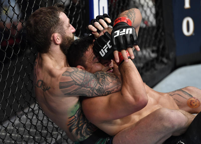 RALEIGH, NORTH CAROLINA - JANUARY 25: (L-R) Michael Chiesa attempts to secure a choke submission against Rafael Dos Anjos of Brazil in their welterweight fight during the UFC Fight Night event at PNC Arena on January 25, 2020 in Raleigh, North Carolina. (Photo by Jeff Bottari/Zuffa LLC via Getty Images)