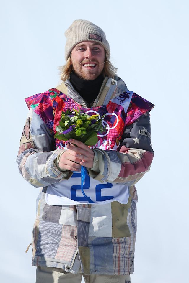 SOCHI, RUSSIA - FEBRUARY 08: Gold medalist Sage Kotsenburg of the United States celebrates on the podium during the flower ceremony following the Snowboard Men's Slopestyle Final during day 1 of the Sochi 2014 Winter Olympics at Rosa Khutor Extreme Park on February 8, 2014 in Sochi, Russia. (Photo by Julian Finney/Getty Images)