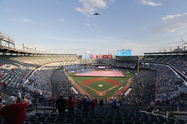 A B-2 bomber flies over Globe Life Park during the playing of the national anthem before a baseball game between the Tampa Rays and Texas Rangers in Arlington, Texas, Wednesday, Sept. 11, 2019. (AP Photo/Tony Gutierrez)