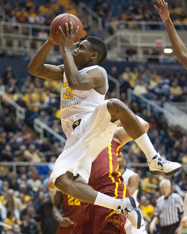 West Virginia's Juwan Staten (3) drives to the basket during the second half of an NCAA college basketball game against Iowa State, Monday, Feb. 10, 2014, in Morgantown, W.Va. West Virginia won 102-77. (AP Photo/Andrew Ferguson)