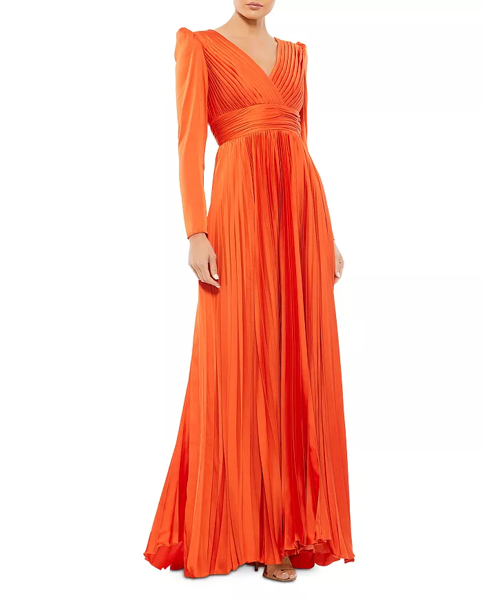 """<br><br><strong>Mac Duggal</strong> Pleated Long Sleeve Gown, $, available at <a href=""""https://go.skimresources.com/?id=30283X879131&url=https%3A%2F%2Fwww.bloomingdales.com%2Fshop%2Fproduct%2Fmac-duggal-pleated-long-sleeve-gown"""" rel=""""nofollow noopener"""" target=""""_blank"""" data-ylk=""""slk:Bloomingdale's"""" class=""""link rapid-noclick-resp"""">Bloomingdale's</a>"""