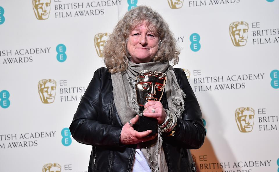 LONDON, ENGLAND - FEBRUARY 14: Jenny Beavan poses with the Best Costume Design Award for 'Mad Max: Fury Road' in the winner's room at the EE British Academy Film Awards at the Royal Opera House on 14 February 2016 in London, England.  (Photo by Ian Gavan / Getty Images)