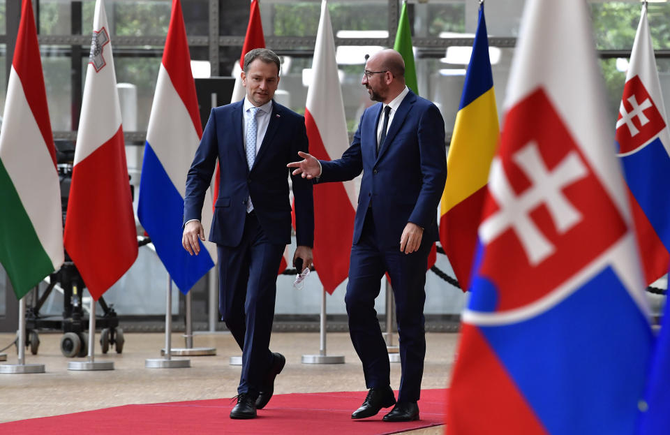 European Council President Charles Michel, right, welcomes Slovakia's Prime Minister Igor Matovic prior to a meeting at the European Council building in Brussels, Thursday, July 16, 2020. (John Thys, Pool Photo via AP)