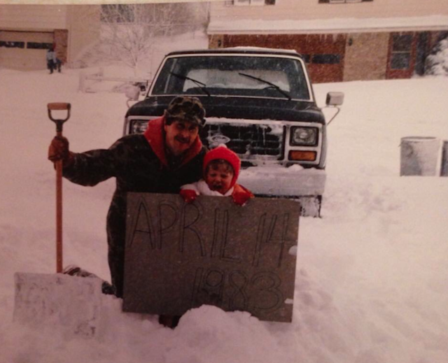 Aaron Brown and his father pose for a photo after a record-breaking snowfall on April 14, 1983. (Photo: Aaron Brown via Twitter)