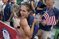 Elle Purrier St. Pierre, left, hugs Lianne Farber after winning the women's 1500-meter run at the U.S. Olympic Track and Field Trials Monday, June 21, 2021, in Eugene, Ore. (AP Photo/Ashley Landis)