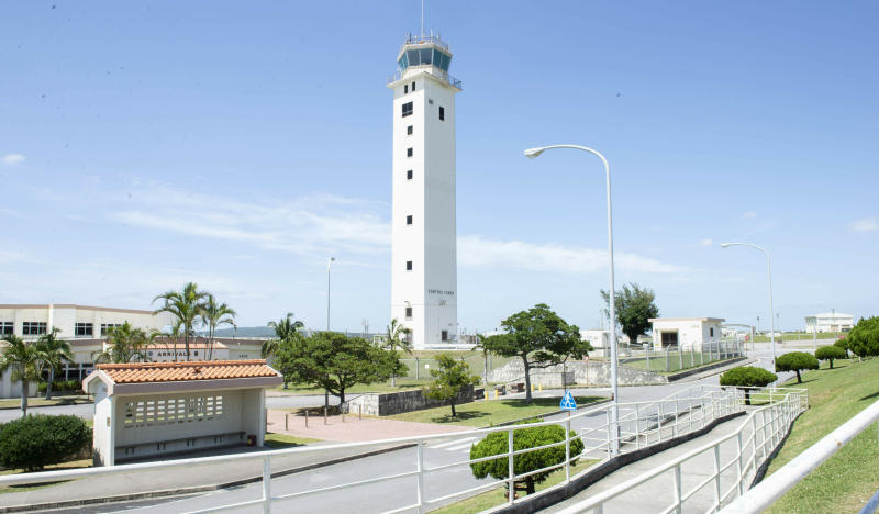 This May 24, 2018 photo made available by the U.S. Air Force shows the air traffic control tower for the Kadena Air Base airfield in Japan. The Defense Department has been figuring out how to provide help and justice when the children of service members sexually assault each other on military bases since Congress required reforms in 2018. Those reforms are starting to rollout, but as one current case at Kadena shows, that rollout has been uneven. (Staff Sgt. Jessica H. Smith/U.S. Air Force via AP)