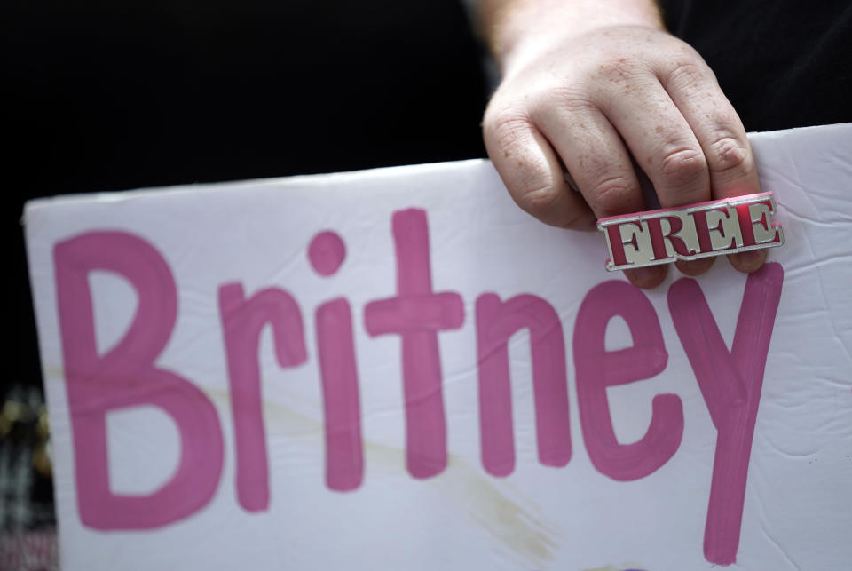 A Britney Spears supporter holds a sign outside a court hearing concerning the pop singer's conservatorship at the Stanley Mosk Courthouse, Wednesday, June 23, 2021, in Los Angeles. (AP Photo/Chris Pizzello)
