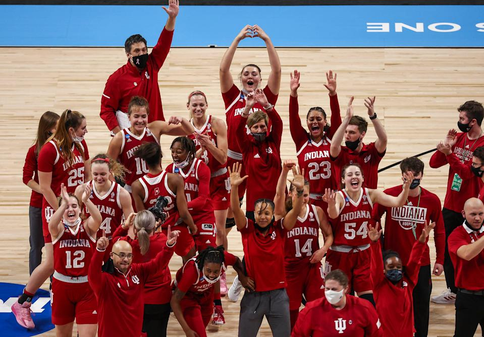 Indiana players and coaches wave to the crowd after the Hoosiers defeated No. 1 seed NC State in the Sweet 16.