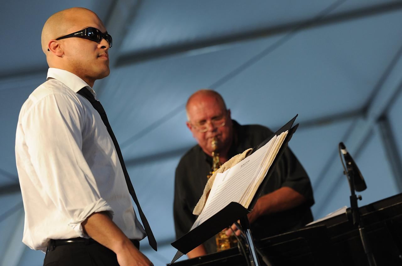 NEW ORLEANS, LA - APRIL 28:  Irvin Mayfield & the New Orleans Jazz Orchestra and Dr. Ed Petersen during the 2012 New Orleans Jazz & Heritage Festival Day 2 at the Fair Grounds Race Course on April 28, 2012 in New Orleans, Louisiana.  (Photo by Rick Diamond/Getty Images)