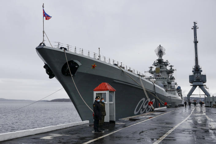 Russian sailors stand guard at the Northern Fleet's flagship, the Pyotr Veilikiy (Peter the Great) missile cruiser, at its Arctic base of Severomorsk, Russia, Thursday, May 13, 2021. Adm. Alexander Moiseyev, the commander of Russia's Northern Fleet griped Thursday about increased NATO's military activities near the country's borders, describing them as a threat to regional security. (AP Photo/Alexander Zemlianichenko)