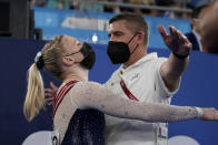 Jade Carey, of the United States, embraces her coach after performing on the floor exercise during the artistic gymnastics women's apparatus final at the 2020 Summer Olympics, Monday, Aug. 2, 2021, in Tokyo, Japan. (AP Photo/Ashley Landis)