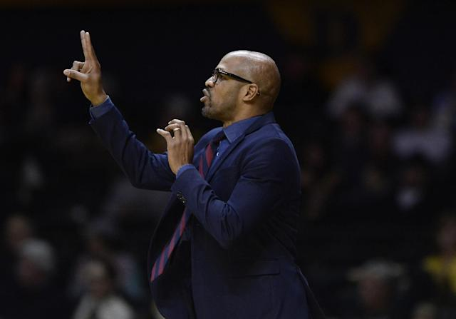"<a class=""link rapid-noclick-resp"" href=""/nba/teams/bos"" data-ylk=""slk:Boston Celtics"">Boston Celtics</a> assistant Jerome Allen has been accused of accepting a bribe when he was the head coach at Penn. (AP Photo/Mark Zaleski)"