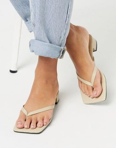 "<p>A low heel and subtle color make these easy to pair with just about anything.</p> <p><a href=""https://www.popsugar.com/buy/Monki-Lovisa-Low-Heel-Thong-Sandal-573323?p_name=Monki%20Lovisa%20Low%20Heel%20Thong%20Sandal&retailer=asos.com&pid=573323&price=48&evar1=fab%3Aus&evar9=47446893&evar98=https%3A%2F%2Fwww.popsugar.com%2Ffashion%2Fphoto-gallery%2F47446893%2Fimage%2F47463334%2FMonki-Lovisa-Low-Heel-Thong-Sandal&list1=sandals%2Cshoes%2Ctrends%2Csummer%2Cfashion%20shopping&prop13=api&pdata=1"" class=""link rapid-noclick-resp"" rel=""nofollow noopener"" target=""_blank"" data-ylk=""slk:Monki Lovisa Low Heel Thong Sandal"">Monki Lovisa Low Heel Thong Sandal</a> ($48)</p>"