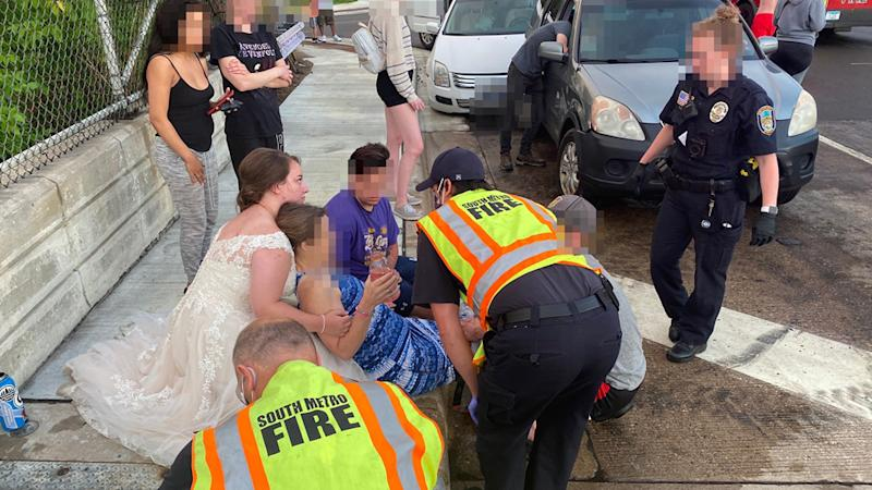 A Minnesota bride in her wedding dress helps a woman who was involved in a car accident.