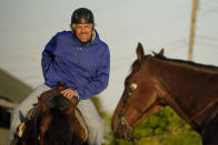 Trainer Steve Asmussen waits to take Kentucky Derby hopeful Super Stock on the track at Churchill Downs Tuesday, April 27, 2021, in Louisville, Ky. Asmussen's parents co-own the horse along with a partner. (AP Photo/Charlie Riedel)