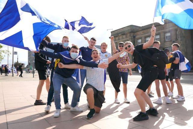The sun came out for these Scotland fans in Glasgow