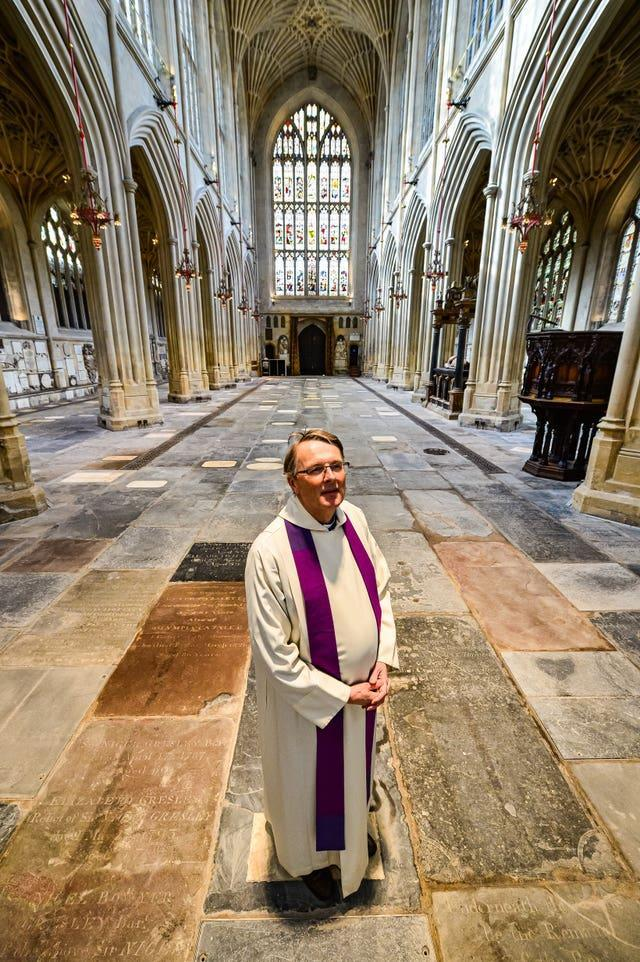 The Rector of Bath Abbey, Canon Guy Bridgewater, looks at the completed thermal heating works inside the famous Abbey (Ben Birchall/PA).