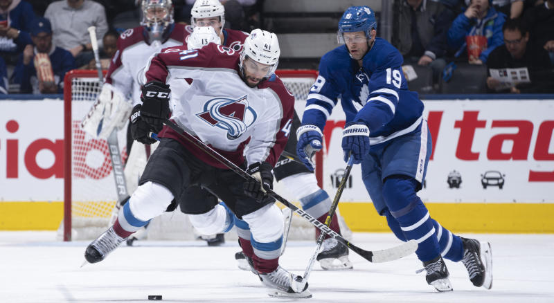 Jason Spezza of the Toronto Maple Leafs battles for the puck against Pierre-Edouard Bellemare of the Colorado Avalanche during the second period of Wednesday's game at the Scotiabank Arena. (Photo by Mark Blinch/NHLI via Getty Images)