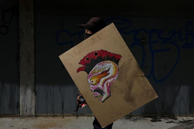 "<p>A demonstrator holding a rudimentary shield, poses for a picture before a rally against Venezuelan President Nicolas Maduro's government in Caracas, Venezuela, May 27, 2017. He said: ""I protest for my future, for the future of my country and so I can wake up tomorrow without any fighting or dictatorship"". (Photo: Carlos Garcia Rawlins/Reuters) </p>"