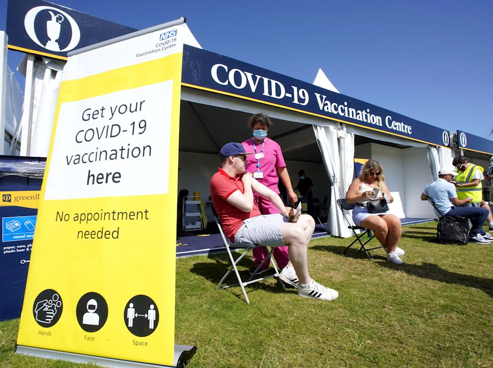 Members of the public get their Covid-19 vaccination between holes (Gareth Fuller/PA) (PA Wire)