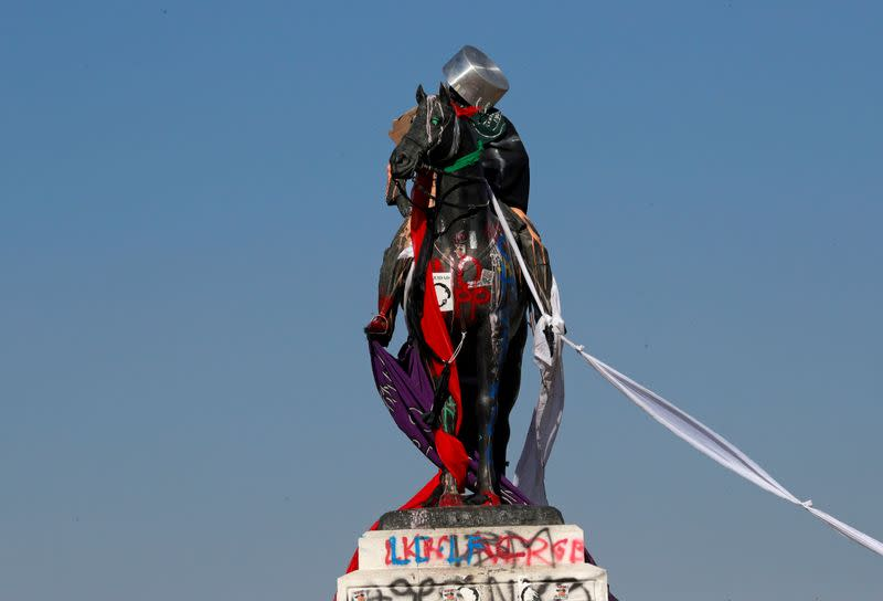FILE PHOTO: A vandalised statue is seen during protests against Chile's government at Plaza Italia in Santiago