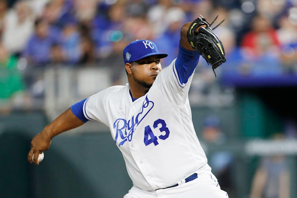 Kansas City Royals relief pitcher Wily Peralta throws to a Chicago Cubs batter during the ninth inning of a baseball game at Kauffman Stadium in Kansas City, Mo., Tuesday, Aug. 7, 2018. (AP Photo/Colin E. Braley)