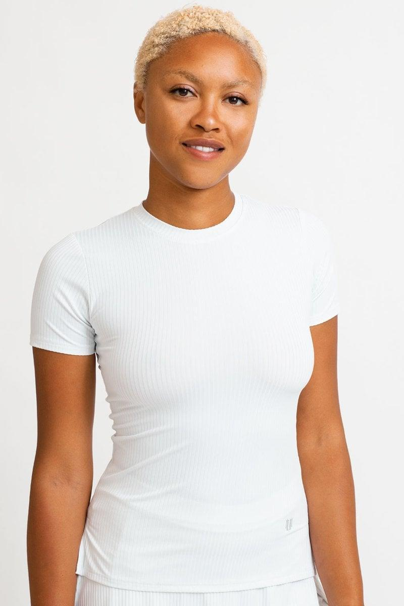 <p>Everyone needs a great white shirt, and this <span>Eleven by Venus Williams Love to Love Rib Tee</span> ($59) is an essential.</p>