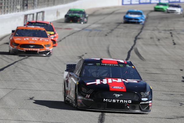 Clint Bowyer, driver of the No. 14 Haas Automation Ford, leads a pack of cars during the Monster Energy NASCAR Cup Series Folds of Honor QuikTrip 500 at Atlanta Motor Speedway on Feb. 24, 2019 in Hampton, Georgia. (Chris Graythen/Getty Images)