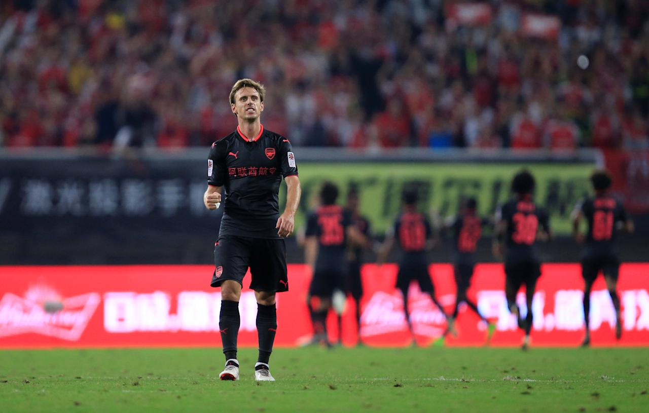 Soccer Football - Bayern Munich vs Arsenal - International Champions Cup - Shanghai, China - July 19, 2017   Arsenal's Nacho Monreal celebrates after Alex Iwobi scored a penalty in the penalty shootout   REUTERS/Aly Song