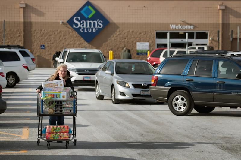 STREAMWOOD, IL - JANUARY 12: A shopper stocks up on merchandise at a Sam's Club store on January 12, 2018 in Streamwood, Illinois. The store is one of more 60 sheduled to close nationwide by the end of January. (Photo by Scott Olson/Getty Images)