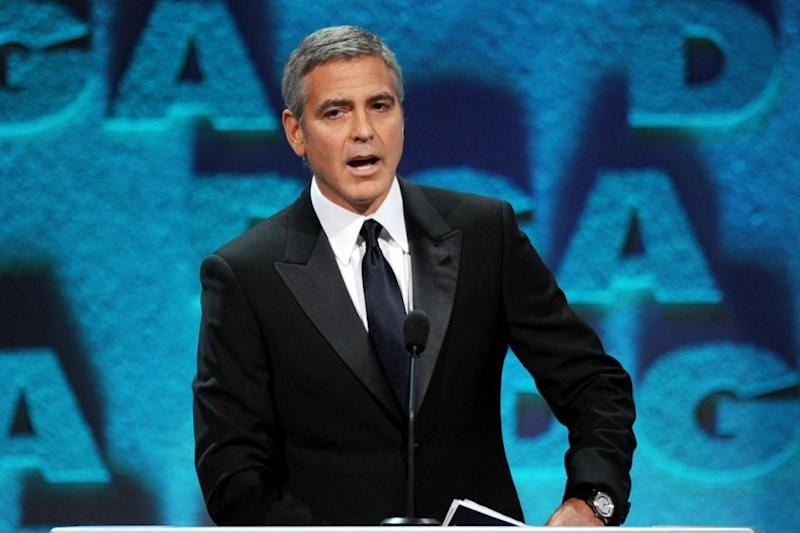 Actor George Clooney speaks onstage during the 64th Annual Directors Guild Of America Awards held at the Grand Ballroom at Hollywood & Highland on January 28, 2012 in Hollywood, California. Source: Getty