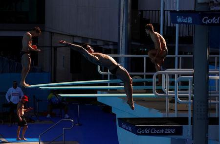 Britain's Tom Daley dives during a team training session ahead of the Commonwealth Games on the Gold Coast in Australia, April 3, 2018. REUTERS/David Gray