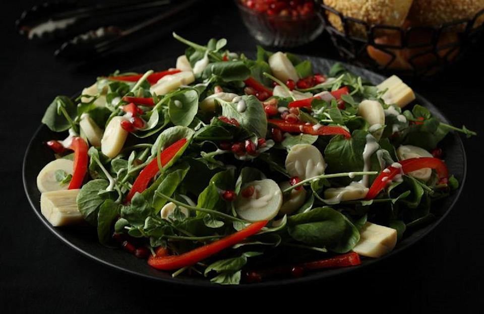 """<p>If you find it hard to incorporate veggies into your diet, try making this salad. Watercress leaves (a member of <a href=""""https://www.thedailymeal.com/cook/cabbage-uses-kinds-recipes?referrer=yahoo&category=beauty_food&include_utm=1&utm_medium=referral&utm_source=yahoo&utm_campaign=feed"""" rel=""""nofollow noopener"""" target=""""_blank"""" data-ylk=""""slk:the cabbage family"""" class=""""link rapid-noclick-resp"""">the cabbage family</a>) and hearts of palm (the inner core of specific palm trees) are tossed with a homemade tahini dressing.</p> <p><a href=""""https://www.thedailymeal.com/recipe/watercress-and-hearts-of-palm-salad-with-tahini-dressing?referrer=yahoo&category=beauty_food&include_utm=1&utm_medium=referral&utm_source=yahoo&utm_campaign=feed"""" rel=""""nofollow noopener"""" target=""""_blank"""" data-ylk=""""slk:For the Watercress and Hearts of Palm Salad With Tahini Dressing recipe, click here."""" class=""""link rapid-noclick-resp"""">For the Watercress and Hearts of Palm Salad With Tahini Dressing recipe, click here.</a></p>"""