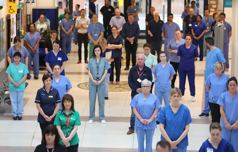 NHS staff at the Mater hospital in Belfast, during a minute's silence to pay tribute to the NHS staff and key workers who have died during the coronavirus outbreak. (Photo by Peter Morrison/PA Images via Getty Images)