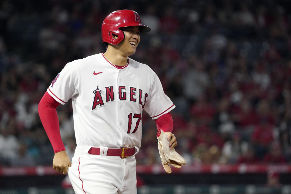 Los Angeles Angels' Shohei Ohtani smiles after being intentionally walked during the sixth inning of a baseball game against the Baltimore Orioles Saturday, July 3, 2021, in Anaheim, Calif. (AP Photo/Mark J. Terrill)