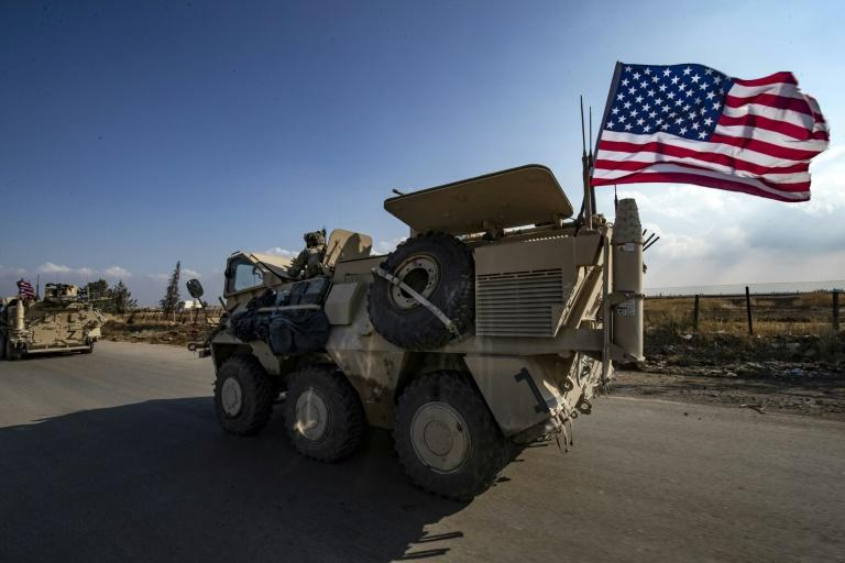 A convoy of US troops is pictured outside the Kurdish-majority city of Qamishli, in Syria's northeastern Hasakeh province on November 2, 2019