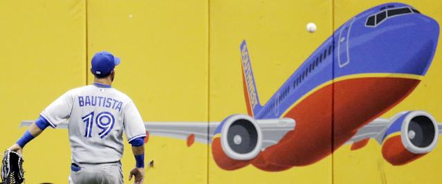 Toronto Blue Jays' Jose Bautista has to play a double hit by Milwaukee Brewers' Khris Davis off the wall during the fifth inning of a baseball game Tuesday, Aug. 19, 2014, in Milwaukee. (AP Photo/Morry Gash)