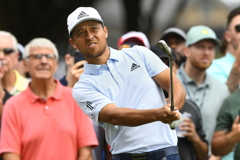 Xander Schauffele hits to the fifth green during the final round of the Tour Championship golf tournament Sunday, Aug. 25, 2019, in Atlanta. (AP Photo/John Amis)