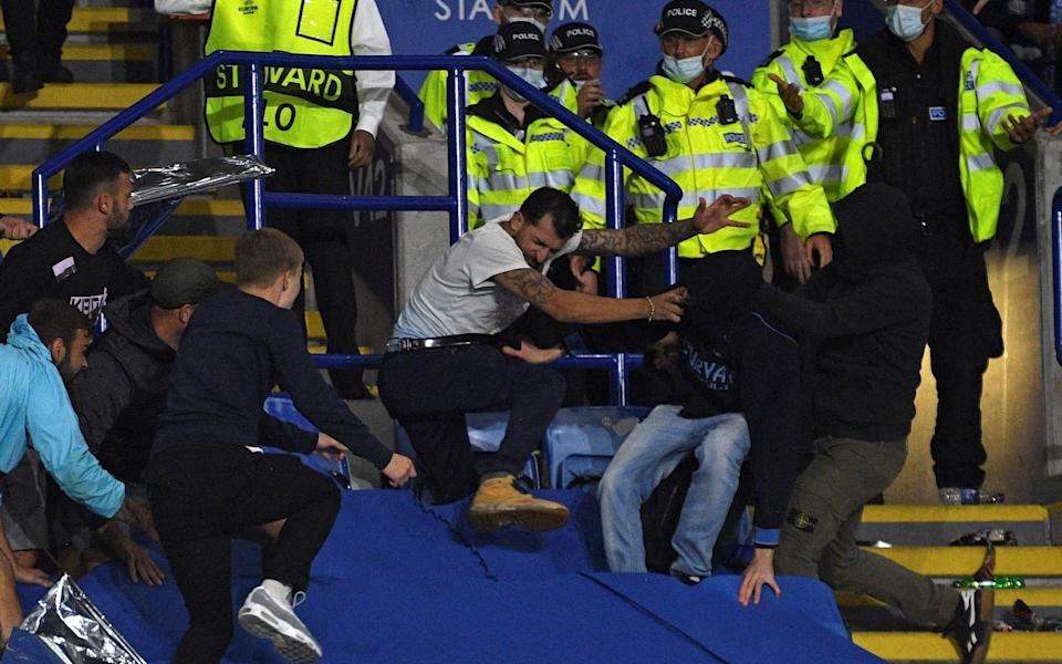 Napoli ultras fight with Leicester City fans and police as violence mars Europa League clash - GETTY IMAGES