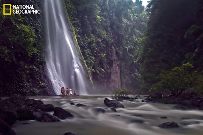 """""""This is one of several waterfalls in Pagsanjan Laguna, Philippines. This place can be reached by shooting the rapids with the local boatmen and their dugout canoes. The rainy season makes the river swell and will make the current even more powerful and navigating the river even more treacherous."""" (Photograph Courtesy Remedy Medina /National Geographic Your Shot)"""