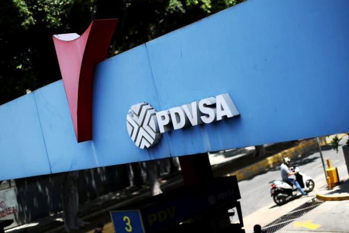 FILE PHOTO: A state oil company PDVSA's logo is seen at a gas station in Caracas
