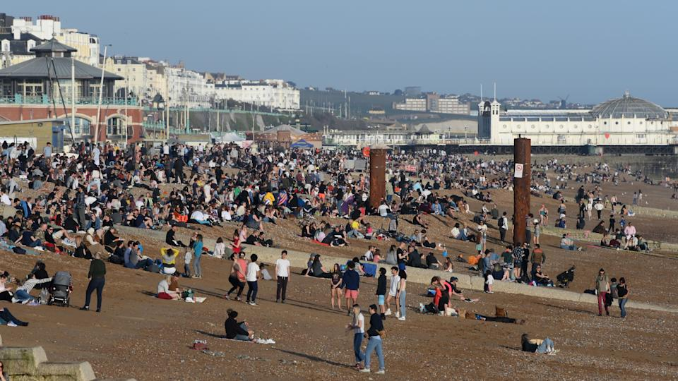 BRIGHTON, UNITED KINGDOM - MARCH 30: People enjoy the warm Spring weather on Brighton beach on March 30, 2021 in Brighton, United Kingdom.  (Photo by Mike Hewitt/Getty Images)