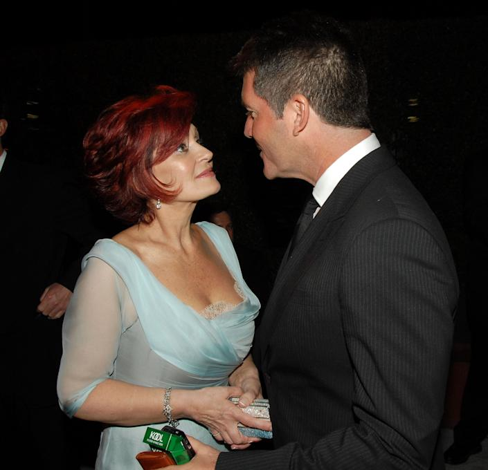 Sharon Osbourne and Simon Cowell during 15th Annual Elton John AIDS Foundation Oscar Party - Viewing Party at Pacific Design Center in West Hollywood, California, United States. (Photo by Kevin Mazur/WireImage)