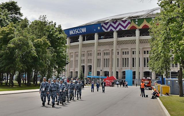<p>Security presence: A line of police patrol Moscow's Luzhniki Stadium on Thursday morning. (EPA) </p>